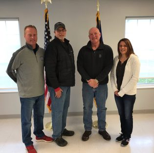 From left to right is Kent Schuerman, Rick Rahe, Dave Bruning, and Fiscal officer Julie Getz.